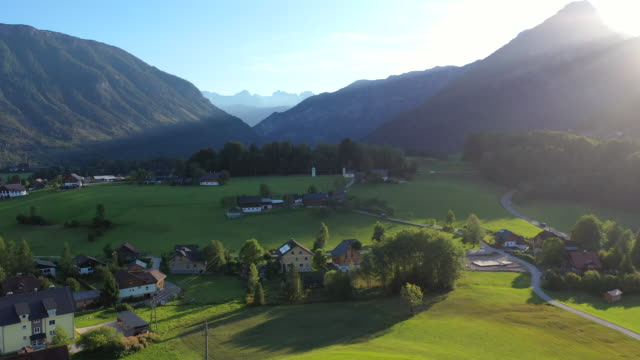 aerial drone movie of village, mountain and lake around hallstatt village, austrian alps, upper austria, europe - traditionally austrian stock videos & royalty-free footage