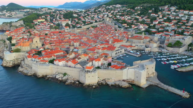 aerial drone movie sunrise scene of dubrovnik old city  in the mediterranean sea, southern croatia.  dubrovnik joined the unesco list of world heritage sites. - mediterranean sea stock videos & royalty-free footage