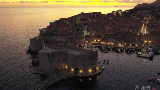 aerial drone movie sunset scene of dubrovnik old city in the mediterranean sea, southern croatia. dubrovnik joined the unesco list of world heritage sites. - old town stock videos & royalty-free footage