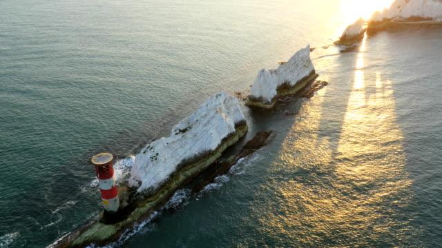 Aerial Drone Needles Alum Bay UK tourism sunrise