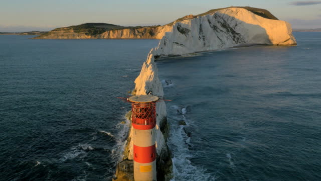 aerial drone needles uk sea helipad tourism - isle of wight stock videos & royalty-free footage