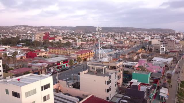 aerial drone ocean view of laplaya tijuana, beachfront, city and the boardwalk in tijuana, mexico - tijuana stock videos & royalty-free footage