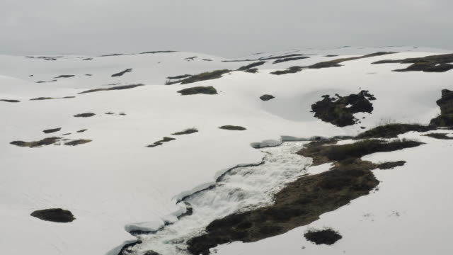 aerial drone outdoors view: frozen mountain area in norway - melting stock videos & royalty-free footage