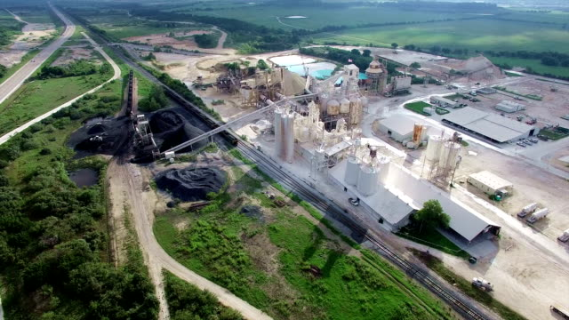 aerial drone over industrial mill surface mine outside of austin texas - opificio video stock e b–roll