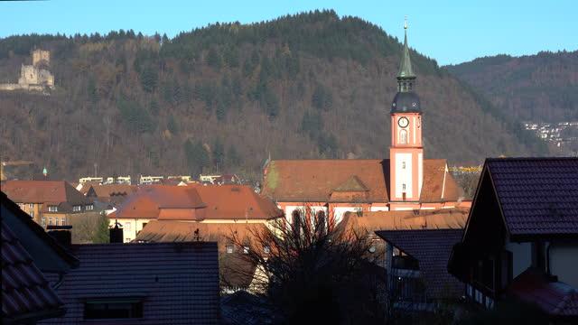 aerial drone panning shot of a church in a small german town on a sunny day - バーデン・ビュルテンベルク州点の映像素材/bロール