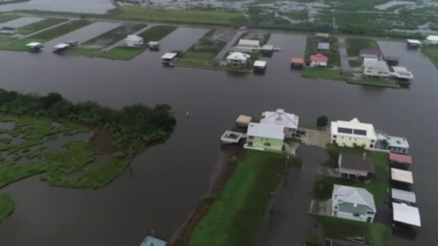 stockvideo's en b-roll-footage met aerial drone panorama shot of a neighborhood flooded from tropical storm barry in myrtle grove louisiana - environment or natural disaster or climate change or earthquake or hurricane or extreme weather or oil spill or volcano or tornado or flooding