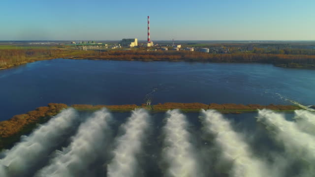 aerial drone panoramic view of the power plant and industrial fountains on cooling basins. - pipe stock videos & royalty-free footage