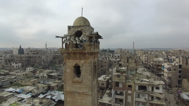 aerial drone panright around the minaret of the 12th century great mosque of maarat alnuman which suffered severe damage in the syrian civil war - circa 12th century stock videos & royalty-free footage