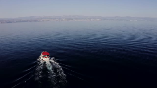 4k aerial drone point of view sailboat on tranquil, sunny blue ocean, real time stock video - yachting stock videos & royalty-free footage