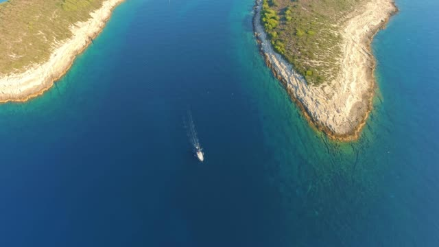 4K Aerial drone point of view sailboat on tranquil, sunny ocean, real time