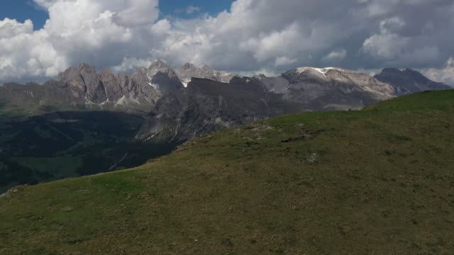 aerial drone revealing shot of mountains in the italian alps - val gardena stock videos & royalty-free footage