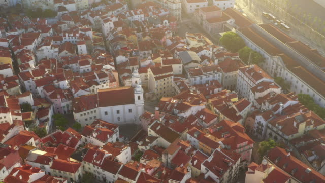 aerial drone rotating shot of a church in lisbon - quartiere residenziale video stock e b–roll
