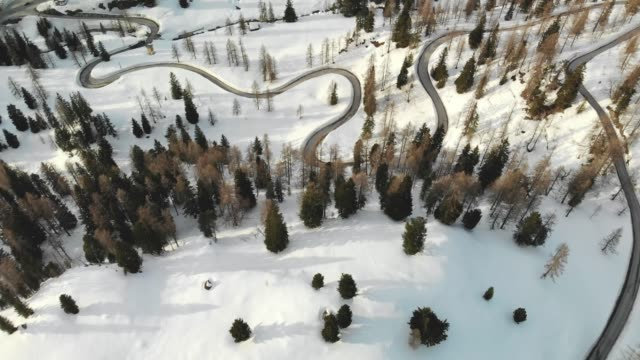 aerial drone shoot of a curvy road in winter wonderland - austria stock videos & royalty-free footage