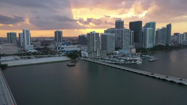 stockvideo's en b-roll-footage met aerial drone shot at sunset over the macarthur causeway in miami, florida. - venetian causeway bridge