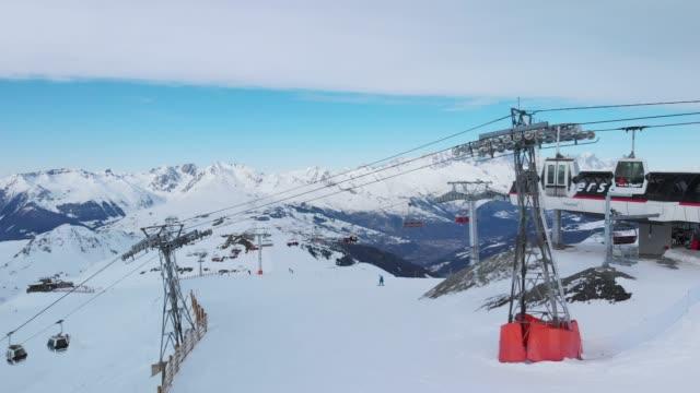 aerial drone shot, la plagne ski resort, tarentaise, savoy, french alps, france, europe - deep snow stock videos & royalty-free footage