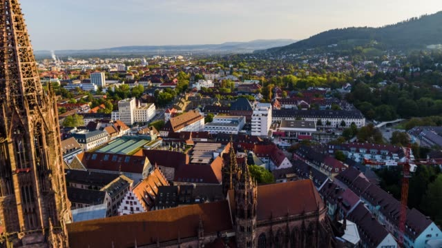 aerial drone shot near an old town with gothic church near freiburg - germany video stock e b–roll