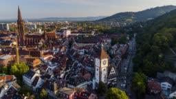 Aerial drone shot near an old town with gothic church near Freiburg