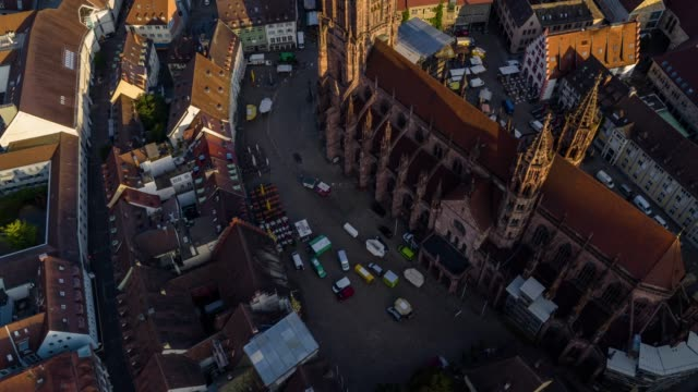 aerial drone shot near an old town with gothic church near freiburg - old town stock videos & royalty-free footage