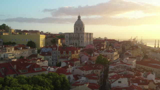 aerial drone shot of a church in lisbon at sunset - portugal stock-videos und b-roll-filmmaterial