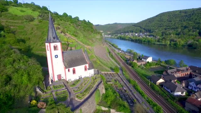 aerial drone shot of a church near mosel - railway track stock videos & royalty-free footage