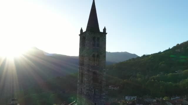 vídeos y material grabado en eventos de stock de aerial drone shot of a church with sun behind - iglesia