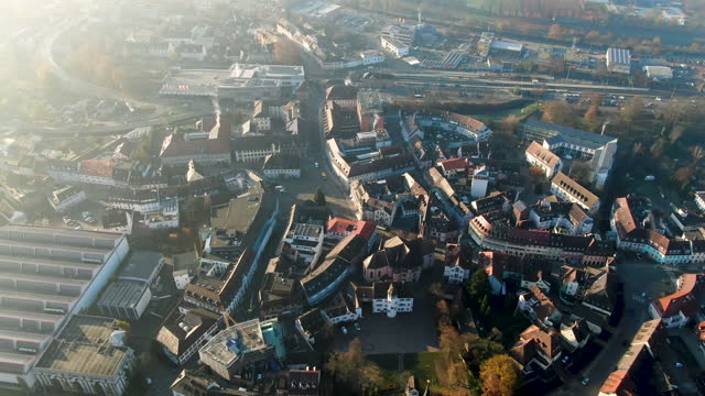 aerial drone shot of a german town with prominent church on a sunny morning - バーデン・ビュルテンベルク州点の映像素材/bロール