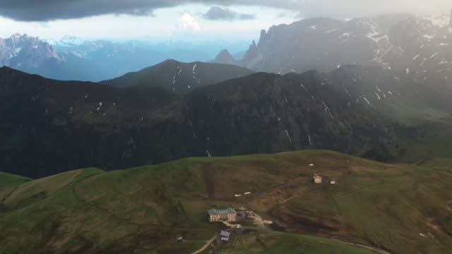 aerial drone shot of a mountain hotel in the italian alps - val gardena video stock e b–roll