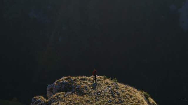aerial drone shot of a photographer standing on the edge of a cliff in durmitor national park - durmitor national park stock videos & royalty-free footage