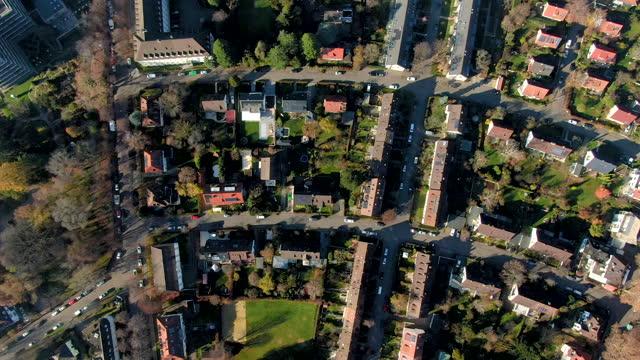 vidéos et rushes de aerial drone shot of a residential area of freiburg - town