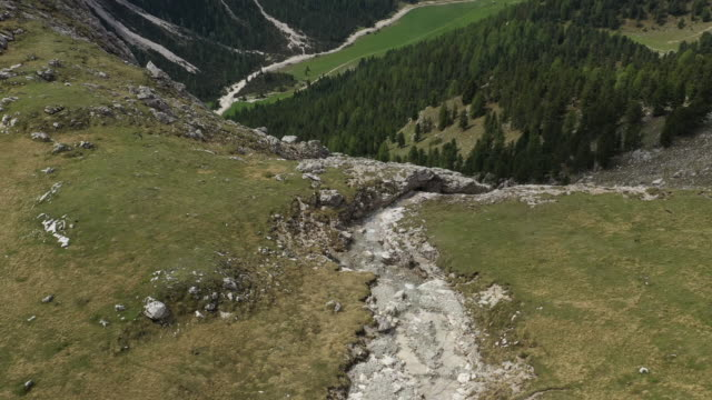 aerial drone shot of a series of waterfalls - val gardena stock videos & royalty-free footage