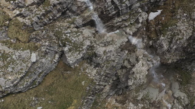 aerial drone shot of a series of waterfalls - val gardena video stock e b–roll