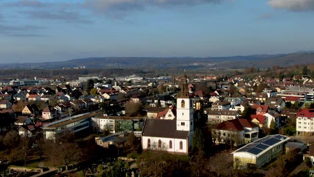 aerial drone shot of a small german town on a sunny day in winter - バーデン・ビュルテンベルク州点の映像素材/bロール