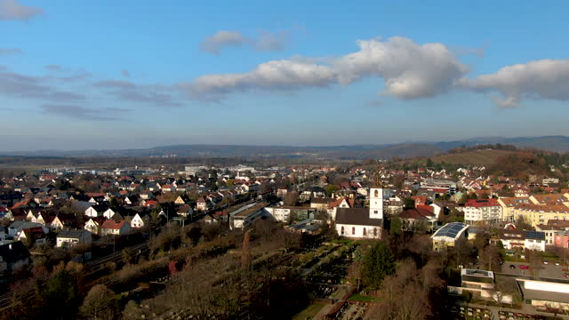 aerial drone shot of a small german town on a sunny day in winter - german culture stock videos & royalty-free footage