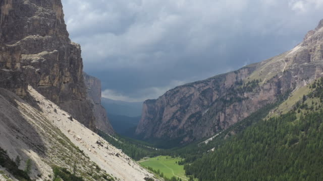 aerial drone shot of a valley with clouds - val gardena video stock e b–roll