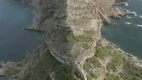 aerial drone shot of an island mountain ridgeline - coastal feature stock videos & royalty-free footage