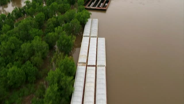 aerial drone shot of barges on the mississippi river in st. louis. - missouri stock videos & royalty-free footage