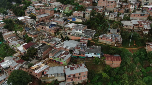 aerial drone shot of comunas in columbia - population explosion stock videos and b-roll footage