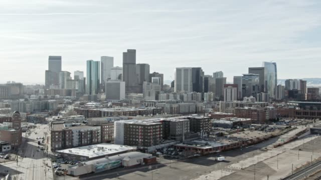 aerial drone shot of downtown denver on a sunny day - colorado stock videos & royalty-free footage