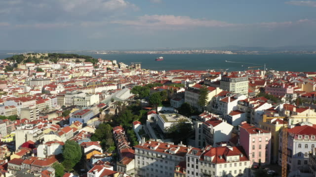 aerial drone shot of downtown lisbon with ocean - lisbon stock videos & royalty-free footage