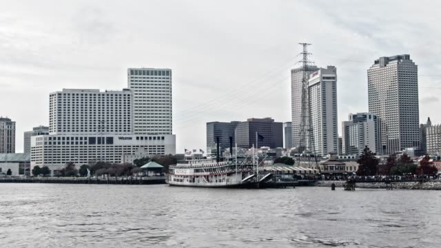aerial drone shot of downtown new orleans/french quarter skyline from the mississippi river under an overcast sky - new orleans stock videos & royalty-free footage