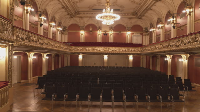 aerial drone shot of empty seats in the ravensburg konzerthaus - stage performance space stock videos & royalty-free footage