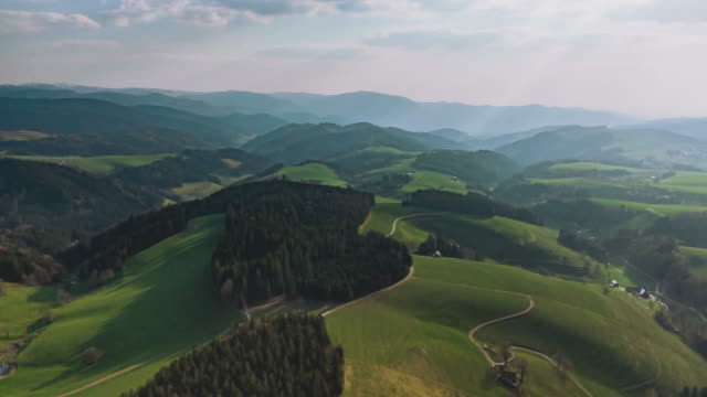 aerial drone shot of forest and hills in schwarzwald germany - baden württemberg stock videos & royalty-free footage