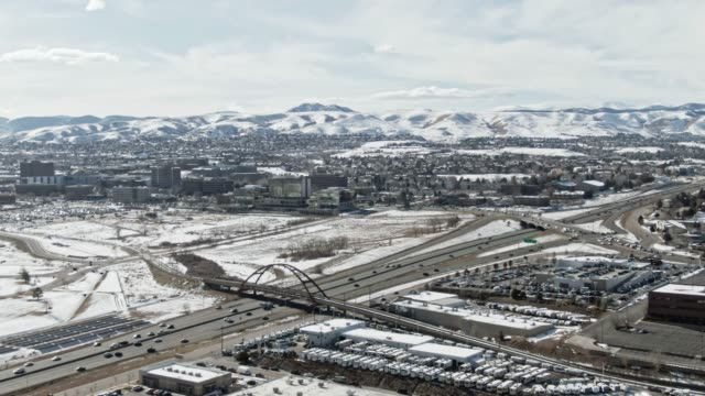 aerial drone shot of interstate 70 running through snowy denver, colorado on a sunny winter day - colorado stock videos & royalty-free footage