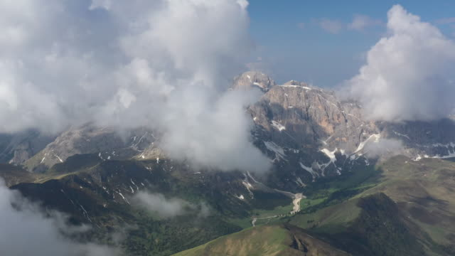 aerial drone shot of low clouds in the italian alps - val gardena video stock e b–roll