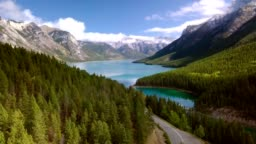 Aerial drone shot of lush greenery of Two Jack Lake in Banff National Park, Alberta, Canada.