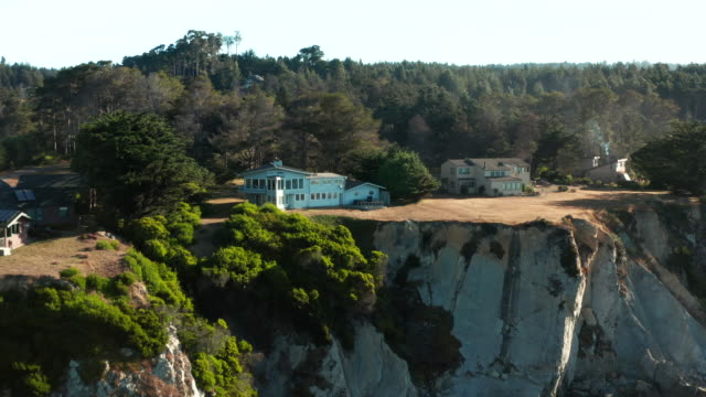 aerial drone shot of northern california coastline and cliffside homes - northern california stock videos & royalty-free footage