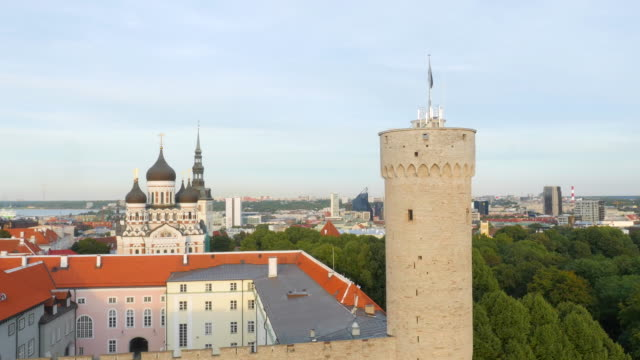 Aerial drone shot of Pikk Hermann and Estonian flag with Parliament building on background