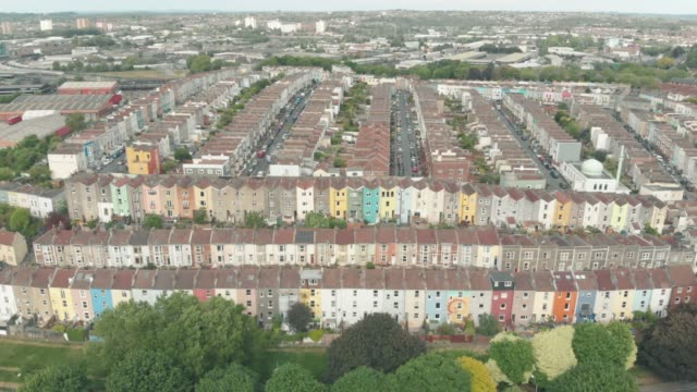 aerial drone shot of rows of colourful terraced houses in the city of bristol, united kingdom. - multi coloured stock videos & royalty-free footage