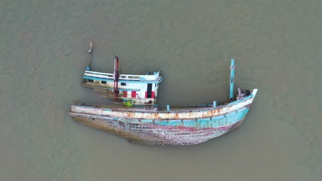 aerial drone shot of shipwreck in sea - sinking stock videos & royalty-free footage