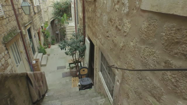 aerial: drone shot of steps and potted plants by old houses - dubrovnik, croatia - steps stock videos & royalty-free footage